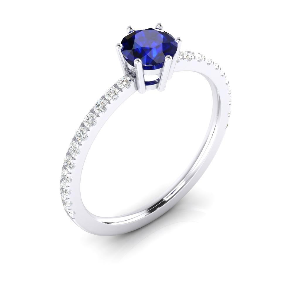 Anell de compromís amb safir talla brillant i diamants