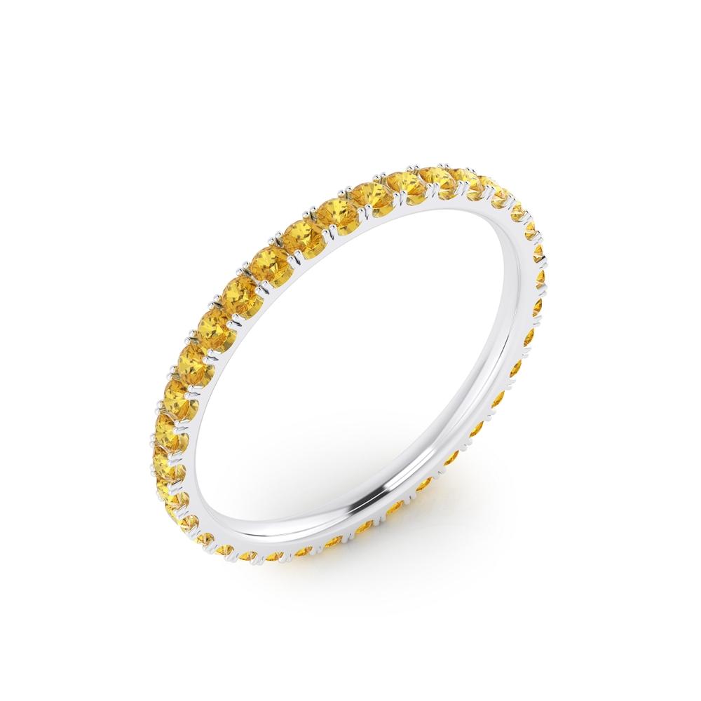 Anell de safirs grocs realitzat en or blanc de 18kt.