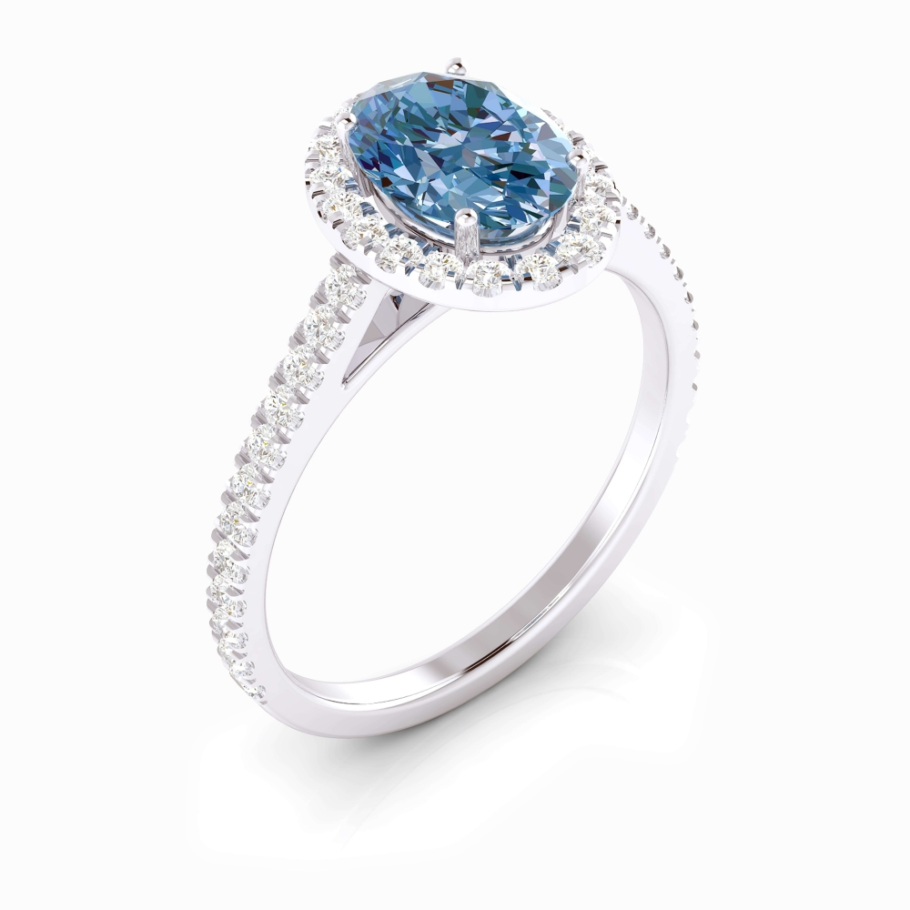 Anell d'or blanc de 18kt amb topazi blau i diamants