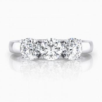 anillo de compromiso oro blanco y 3 diamantes