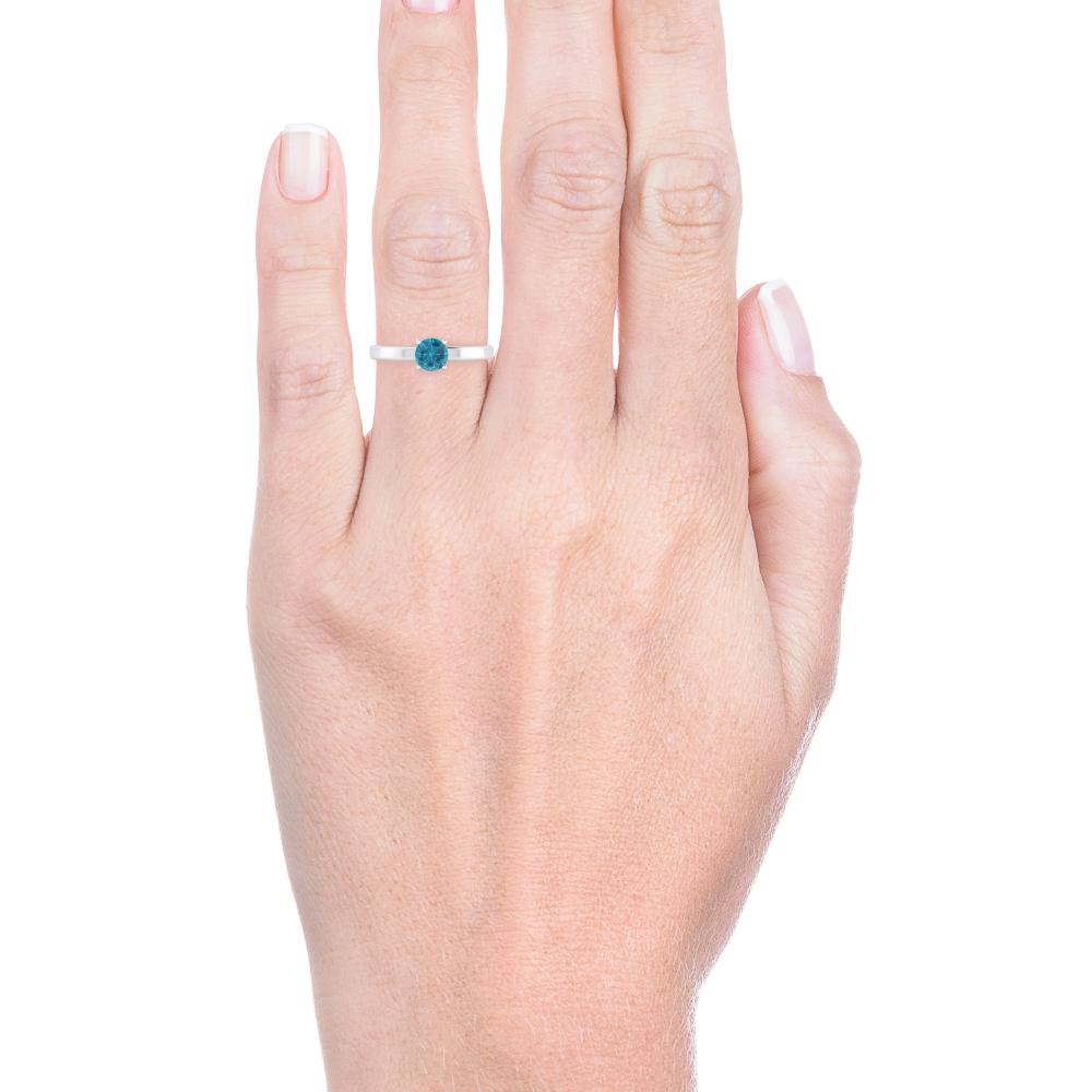 Anell de plata amb un topaci blau