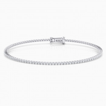 Riviere de diamants d'or blanc de 18kt amb diamants de 0,01qt - grapa rodona