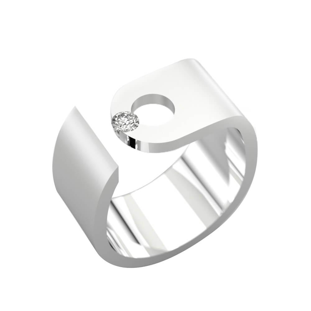 anillo con un diamante y oro blanco