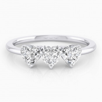White gold ring with three heart-cut shape diamond