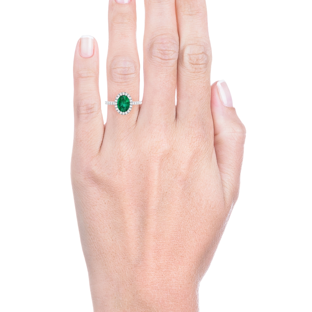 Halo diamond ring with emerald