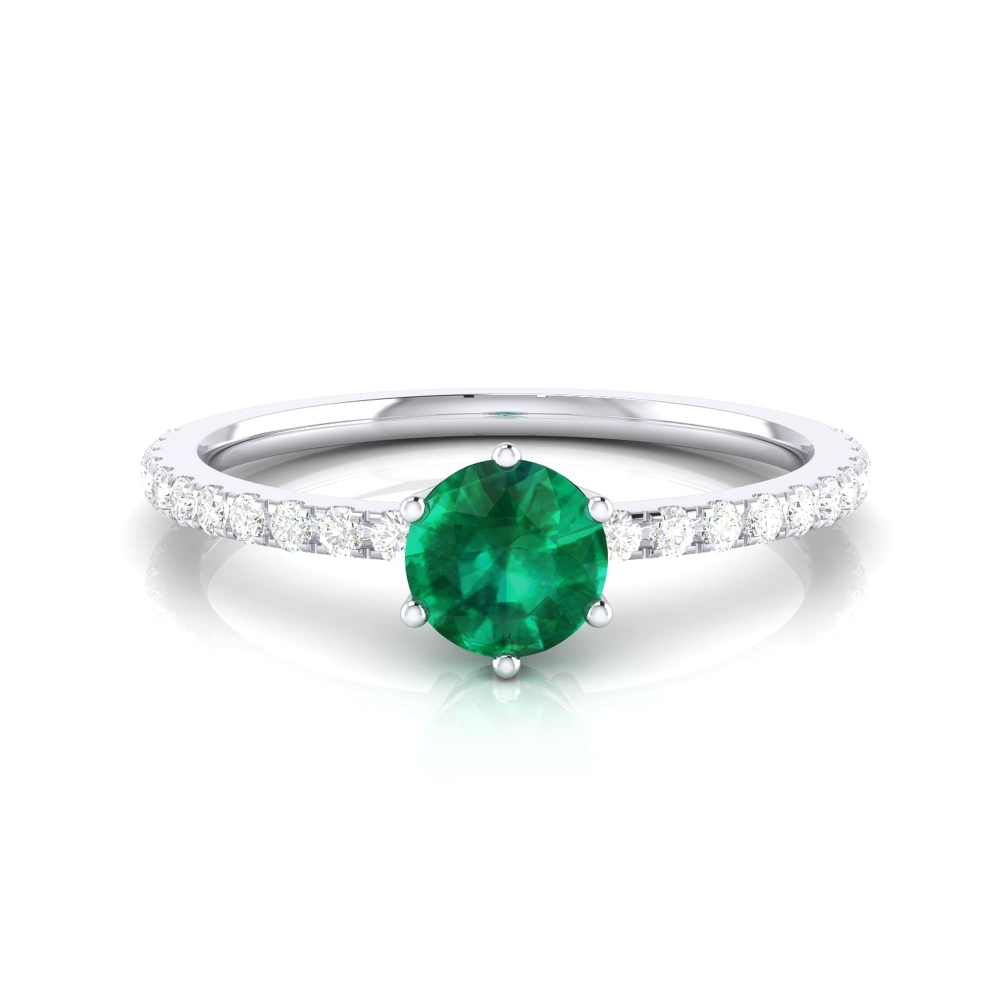 Ring with brilliant cut emerald and diamonds