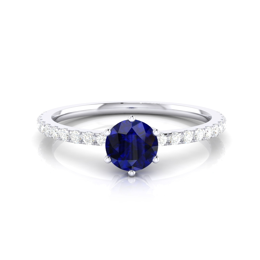 Engagement ring with brilliant cut sapphire and diamonds
