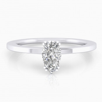 White gold engagement ring with a pear cut shape diamond