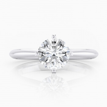 Selected engagement ring, four points, solitary style, 18 k white gold