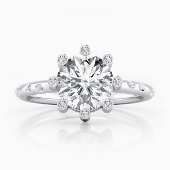 Anillo de compromiso de oro blanco 16 diamantes y 1 diamante central
