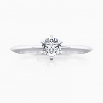 White gold engagement ring with a round cut shape diamond.