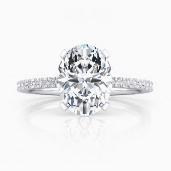 Exclusive 18kt white gold solitaire, with a central oval-cut diamond