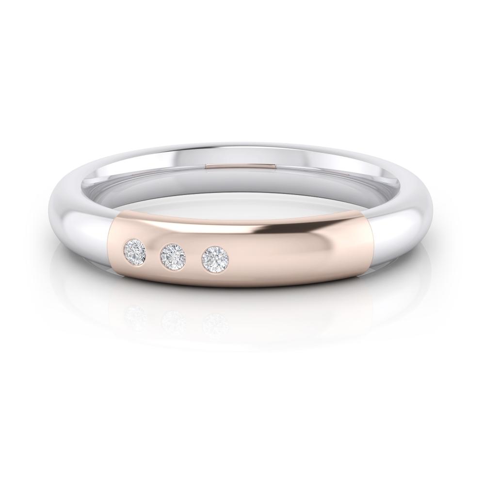 Alianza de boda en oro blanco y rosa estilo media caña, con tres diamantes centrales.