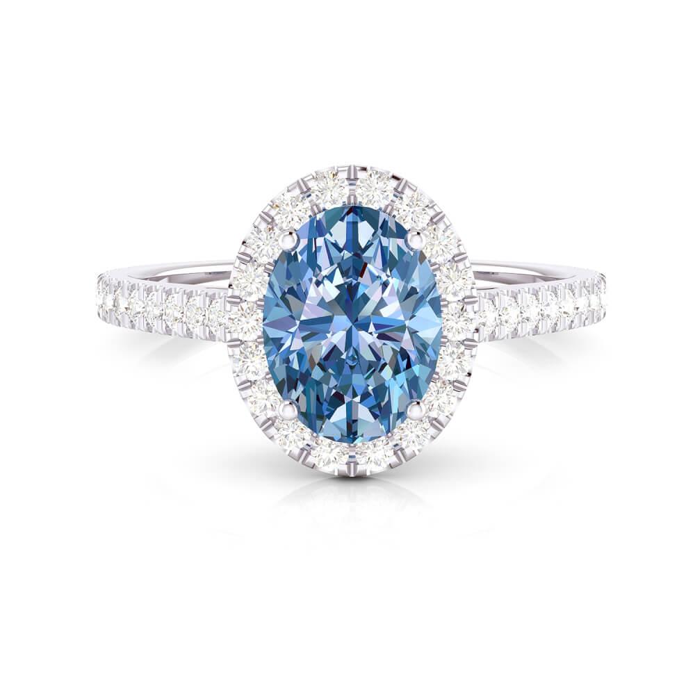 Anillo de compromiso con topacio azul y diamantes