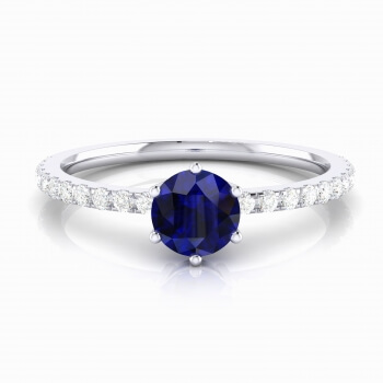 Anillo de compromiso con zafiro talla brillante y diamantes