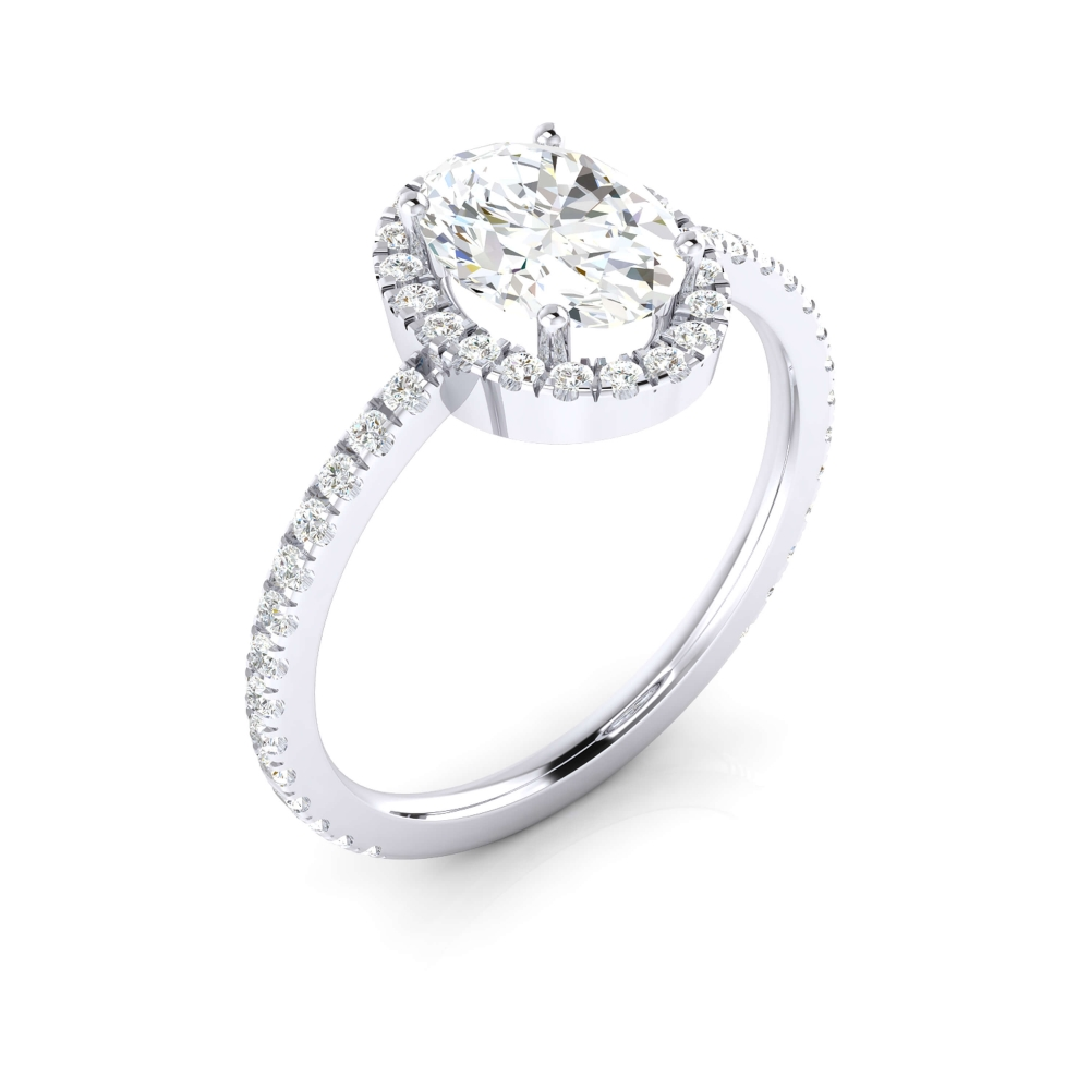 Anillo con diamante oval i orla de brillantes