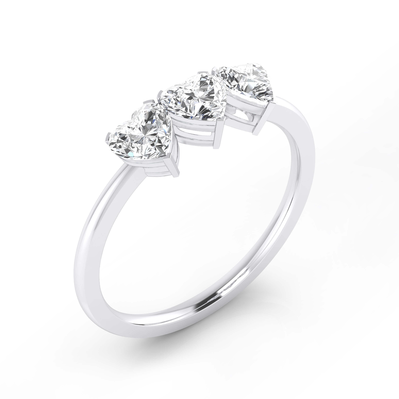 White gold ring with three heart-cut shape diamond