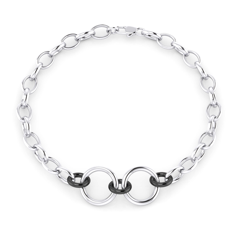 Braçalet home de plata amb tres anelles banyades en rodi negre.